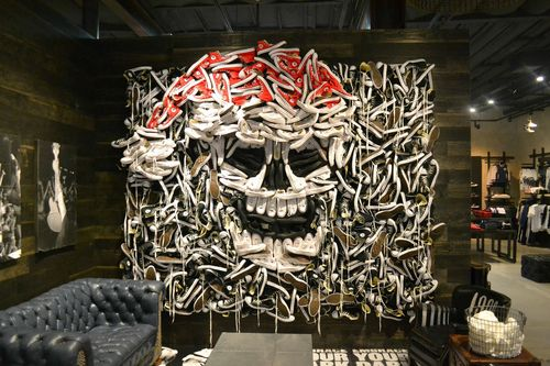 56a2ec9e81c From MrAnd3rsonn  Shoes positioned on a wall to create a skull. This was  captured in a clothes store in LA.